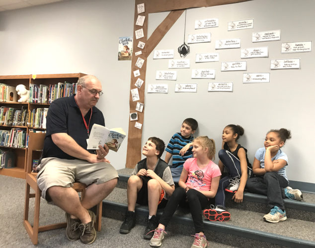 Chateau Striders Lead Tutor, Bruce Larson, reads Charlotte's Web to students during the Love Elementary School's Terrific Kids After School Program.