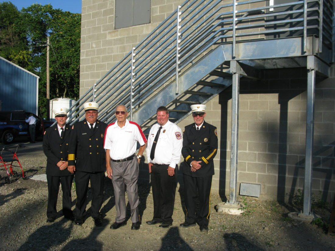 The new burn building at the Raymond C. Taylor Fire Training Center in Jamestown was dedicated Thursday to Frank Stefanelli, former chief of the Jamestown Fire Department and state fire instructor. Pictured, from left, are Jeff Molnar, Julius Leone, Stefanelli, Brian Purol and Denny Barmore.  P-J photo by Eric Tichy