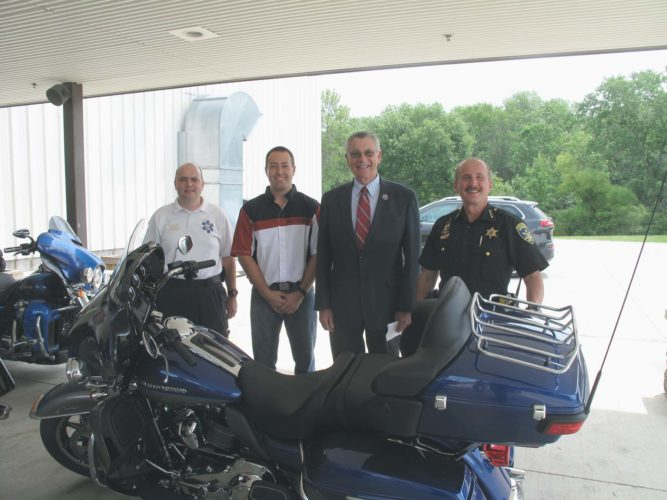 Pictured, from left, are Mike Volpe; Matt Eyring, general manager of Harley Davidson of Jamestown; County Executive Vince Horrigan; and Chautauqua County Sheriff Joe Gerace.  P-J photo by A.J. Rao