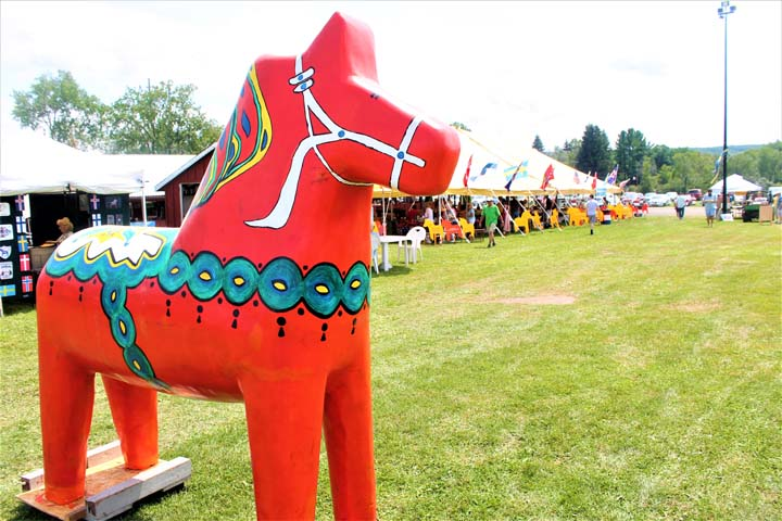 "A ""Dala"" horse, representative of Scandinavian culture, sits inside the Scandinavian Folk Festival, which began Friday at the Gerry Rodeo Grounds. P-J photo by Jordan W. Patterson"