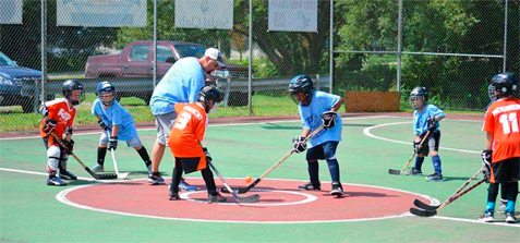 Youth hockey players are pictured participating in the 2016 NCCYHA Street Hockey Tournament held in Dunkirk's Wright Park.  Submitted photo