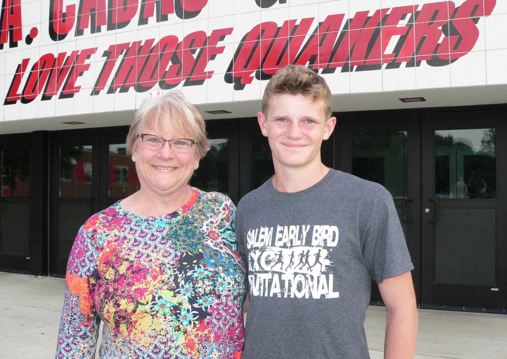 Salem seventh grade English teacher Berni Jesko gives thanks to former student Owen Kirkland, a 16-year-old Salem High School junior who saw smoke and flames inside her house while out running and called for help. She and her husband Tom credited his quick actions with saving their home from total destruction during a recent fire. (Salem News photo by Mary Ann Greier)