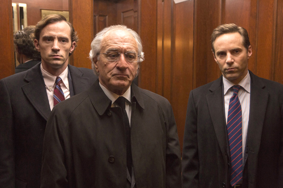 """This image released by HBO shows Nathan Darrow as Andrew Madoff, left, Robert De Niro as Bernie Madoff, center, and Alessandro Nivola as Mark Madoff in """"The Wizard of Lies."""" De Niro was nominated for an Emmy Award for outstanding lead actor in a limited series or movie on Thursday, July 13, 2017. The Emmy Awards ceremony, airing Sept. 17 on CBS, will be hosted by Stephen Colbert. (Craig Blankenhorn/HBO via AP)"""