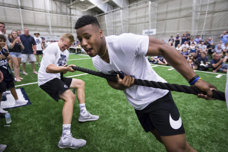 ASSOCIATED PRESS Saquon Barkley teams up with Mike Gesicki during Penn State's Lift for Life Saturday at Holuba Hall on campus.