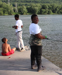 CARA MORNINGSTAR/Sun-Gazette Amontae Pinkley, 11, left, Quian Johnson, 13, center, and Qavell Johnson, 11, right, fish off a dock near Hiawatha Boulevard in Williamsport on Sunday.