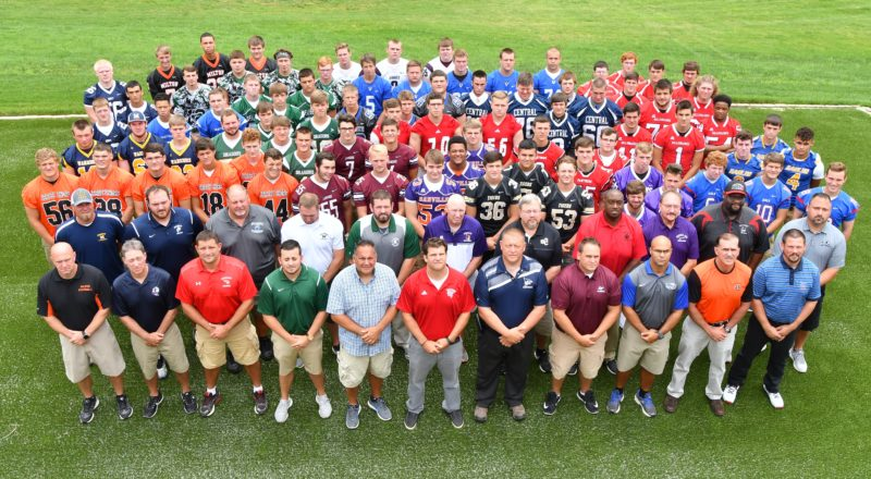 MARK NANCE/Sun-Gazette Players and coaches gather for a group photo at District 4 high school football media day Tuessday at Williamsport Country Club.