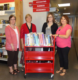 PHOTO PROVIDED From left, are Julie Cimino, director of student accounts at Mansfield university; Dean Nancy Sidell; Amanda Sanko; and Nicole Book, North Hall Library.
