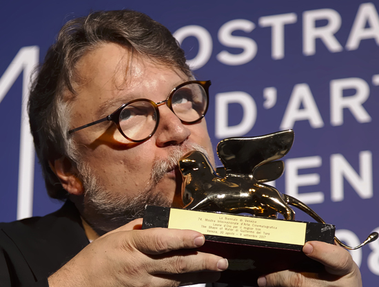 Guillermo del Toro kisses the Golden Lion for best film for 'The Shape Of Water' during the awards photo call at the 74th Venice Film Festival at the Venice Lido, Italy, Saturday, Sept. 9, 2017. (AP Photo/Domenico Stinellis)
