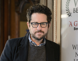"""FILE - In this March 2, 2017 file photo, director-producer J.J. Abrams poses for a portrait to promote """"The Play That Goes Wrong"""" at the Lyceum Theatre in New York. Abrams is returning to ÒStar Wars,Ó and will replace Colin Trevorrow as writer and director of ÒEpisode IX.Ó Disney announced Abrams return on Tuesday, Sept. 12.  (Photo by Christopher Smith/Invision/AP, File)"""