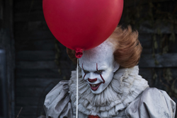 """This image released by Warner Bros. Pictures shows Bill Skarsgard in a scene from """"It."""" (Brooke Palmer/Warner Bros. Pictures via AP)"""