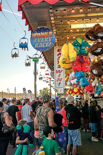 PHOTO PROVIDED A crowd gathers around midway games during last year's Bloomsburg Fair. The show starts on Friday and continues through Sept. 30.