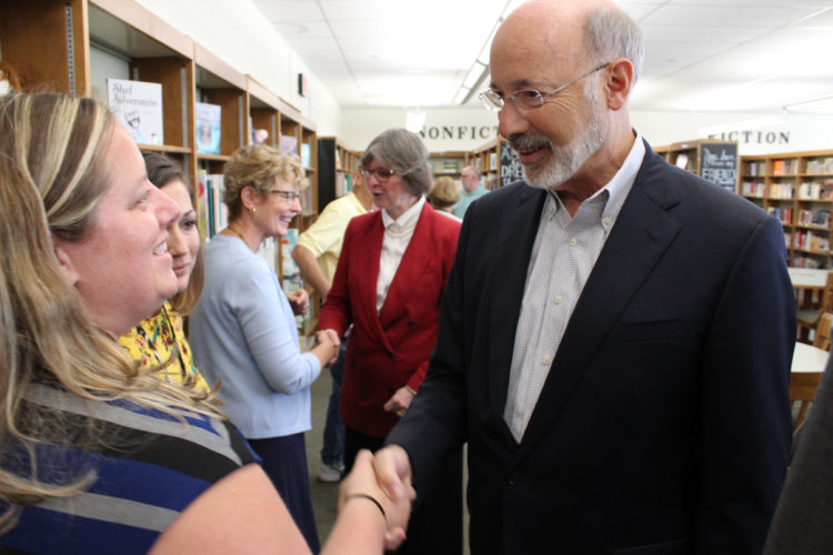 CARA MORNINGSTAR/Sun-Gazette Gov. Tom Wolf, center, shakes hands with Ashley Smith, sixth-grade math teacher, during his visit to Warren L. Miller Elementary school in Mansfield on Thursday. Behind the governor, his wife, Frances Wolf, shakes hands with Nan Wilcox, reading specialist, left.