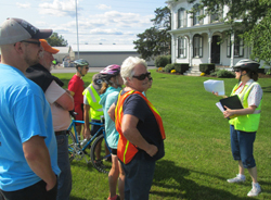 "PHOTO PROVIDED The Mifflinburg Buggy Museum recently sponsored a ""Cycling Through the Centuries"" historic bike tour. Here, guide Mary Sullivan, right, discusses the Pontius farm and its connection to William Penn. Additional tours will be offered next year, so watch Mifflinburg Buggy Museum's Facebook for details."