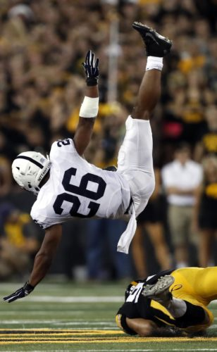 ASSOCIATED PRESS Penn State running back Saquon Barkley (26) is upended by Iowa defensive end A.J. Epenesa during the first half Saturday in Iowa City.