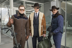 """FILE - This file image released by Twentieth Century Fox shows, from left, Taron Egerton, Colin Firth, and Pedro Pascal in """"Kingsman: The Golden Circle."""" The R-rated spy comedy ÒKingsman: The Golden CircleÓ has taken over the top spot at the North American box office with an estimated $39 million debut. The 20th Century Fox release pushed the Stephen King sensation ÒItÓ into second place in its third week of release.(Giles Keyte/Twentieth Century Fox via AP, File)"""