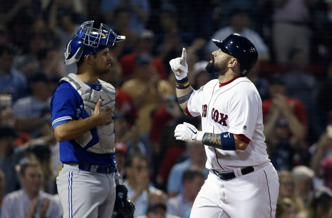 f69819dd Boston Red Sox's Sandy Leon, right, celebrates his two-run home run in  front of Toronto Blue Jays' Luke Maile during the eighth inning of a  baseball game ...