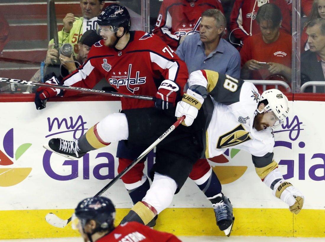 1ce48dda6f9 ASSOCIATED PRESS Washington Capitals defenseman John Carlson (74) checks  Vegas Golden Knights forward James Neal (18) during the second period in  Game 4 of ...