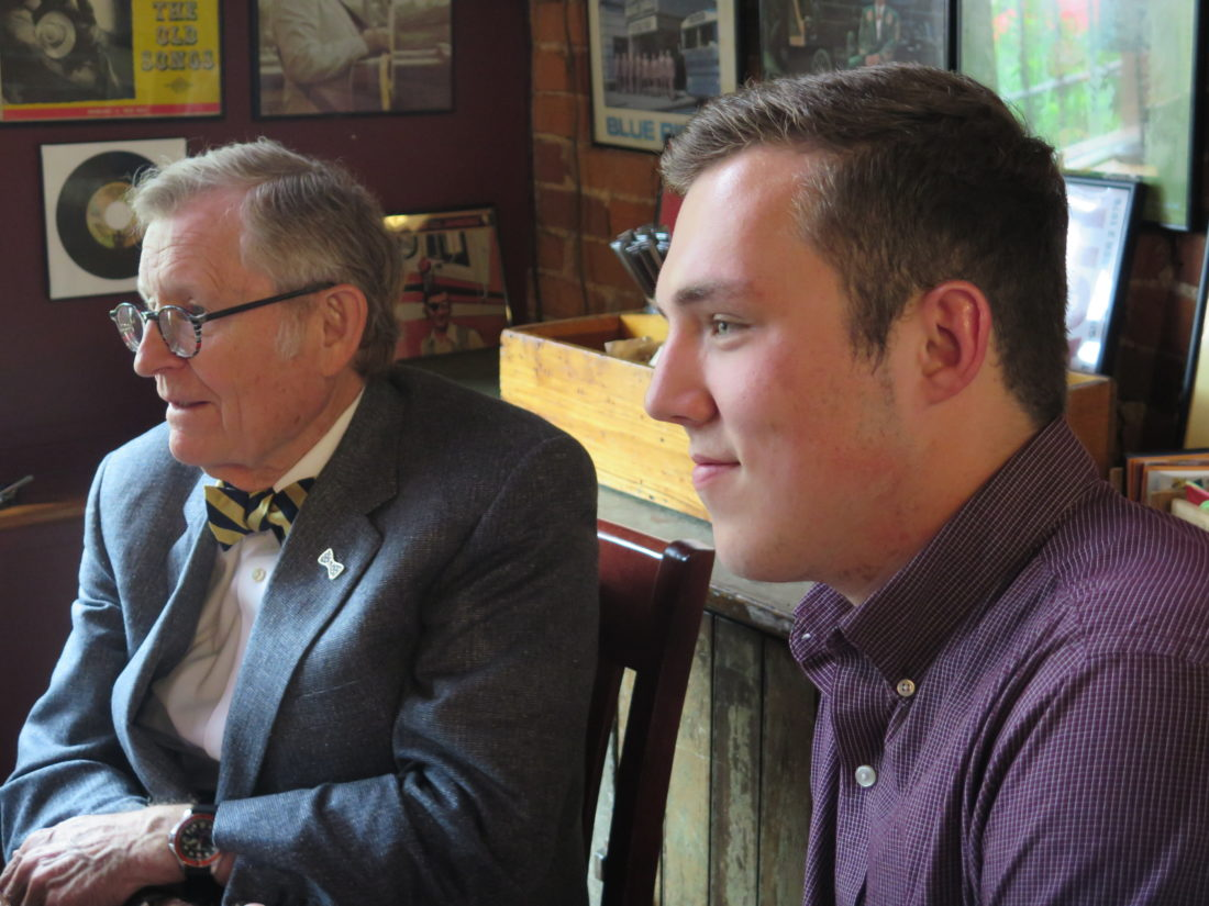 Photo by Joselyn King West Virginia University President E. Gordon Gee, left, and WVU Student Body President Blake Humphrey meet with Ohio County and Wheeling officials Wednesday at Later Alligator in Wheeling.