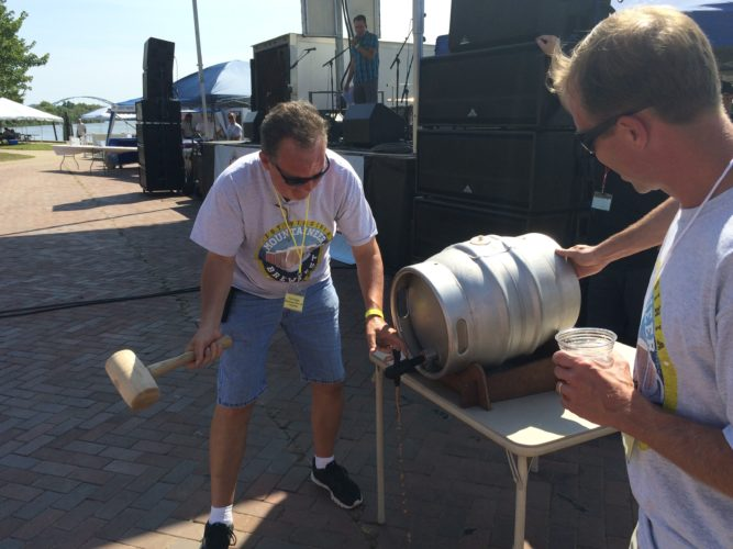 File Photo Mountaineer Brewfest founder Jeff Hayes taps a keg during a past event.