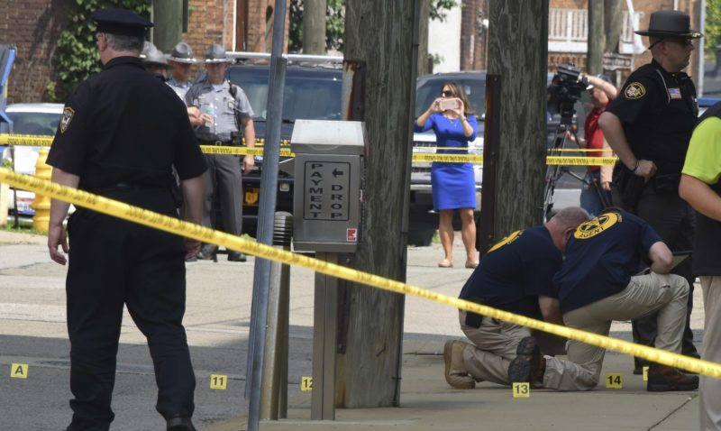 Evidence markers are placed on N. Court Street and the sidewalk next to the Jefferson County Courthouse in Steubenville , Ohio, Monday Aug. 21, 2017, after Jefferson County Judge Joseph Bruzzese Jr. was ambushed and shot early Monday morning. Jefferson County Sheriff Fred Abdalla says courthouse video shows Bruzzese firing about five shots at the gunman, who also fired about five shots before a probation officer ultimately killed the suspect. (Darrell Sapp//Pittsburgh Post-Gazette via AP)