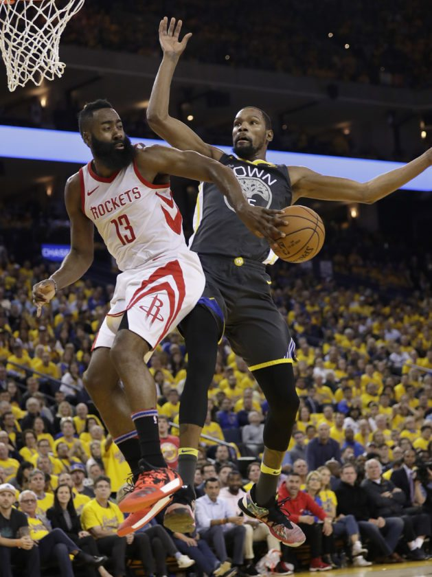 1cc3b2469 Houston Rockets guard James Harden (13) passes behind Golden State Warriors  forward Kevin Durant during the first half of Game 4 of the NBA basketball  ...