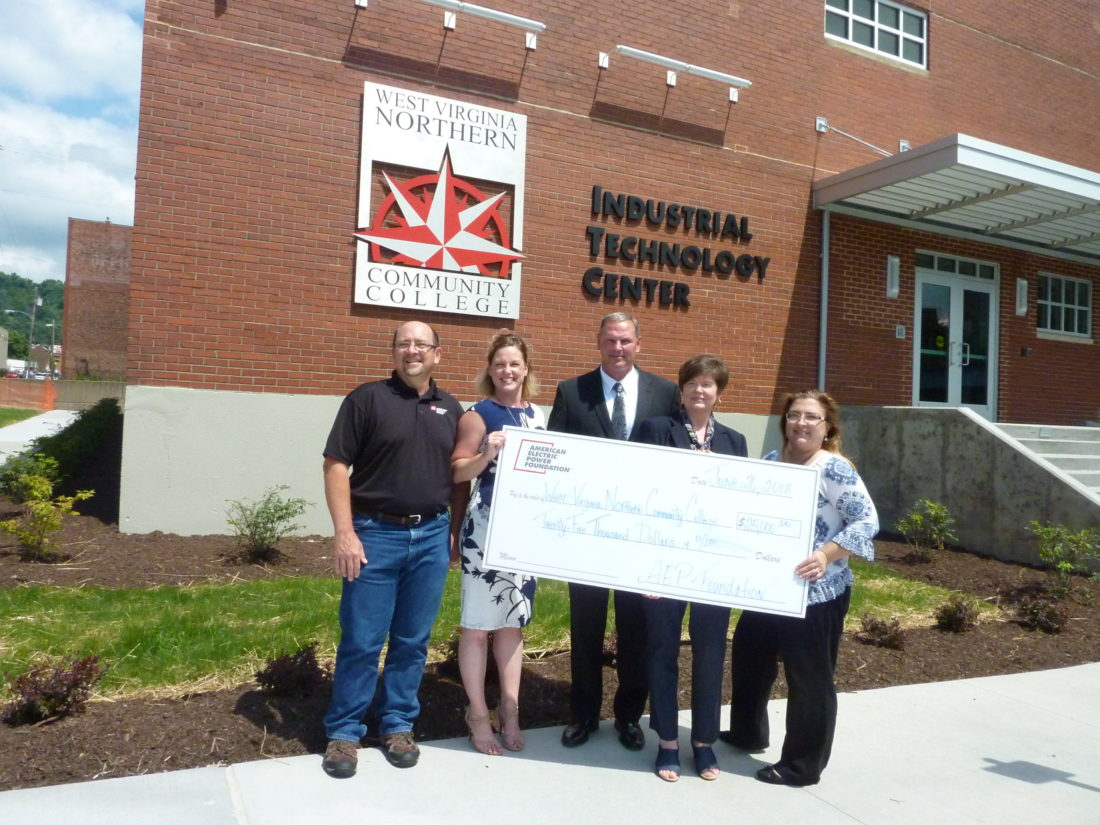 Photo by Linda Comins Presenting a $25,000 grant from AEP for West Virginia  Northern Community College's new Industrial Technology Center Tuesday are,  ...