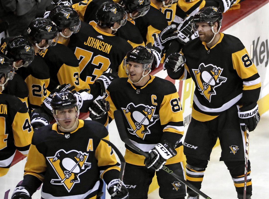 38bbfbe29da Pittsburgh Penguins  Sidney Crosby (87) celebrates his third-period goal as  he returns to the bench with Evgeni Malkin (71) and Phil Kessel (81) in an  NHL ...
