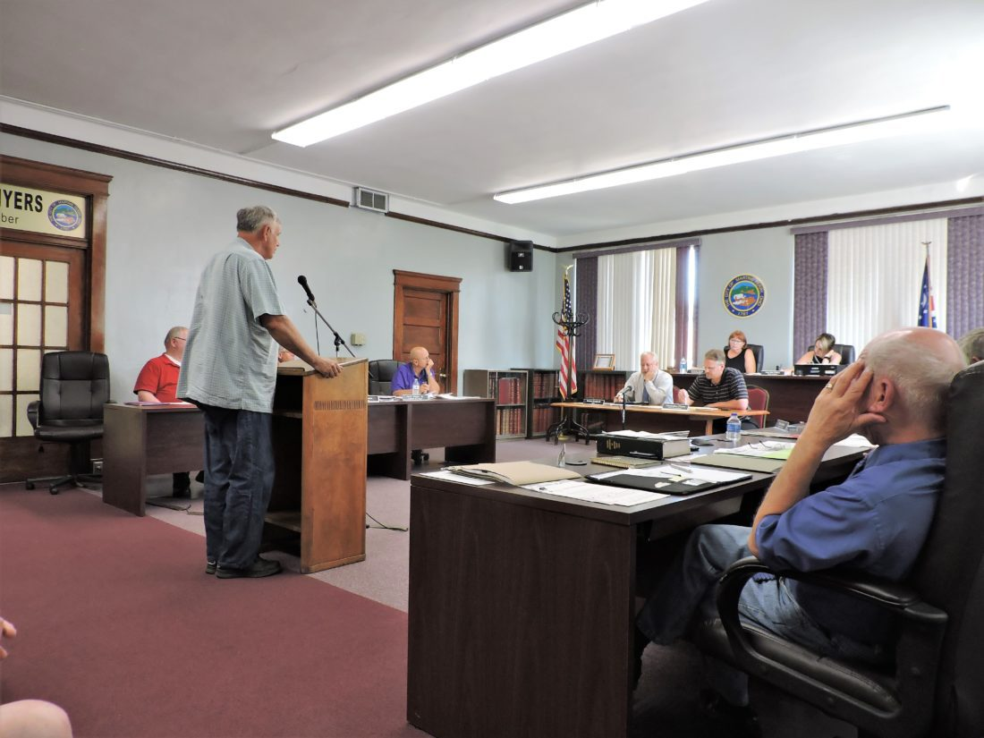 T-L Photos/SHELLEY HANSON MONROE STREET resident Richard Lewellen on Wednesday tells Martins Ferry City Council about a sewage backup that occurred in his basement during a recent heavy rainfall.
