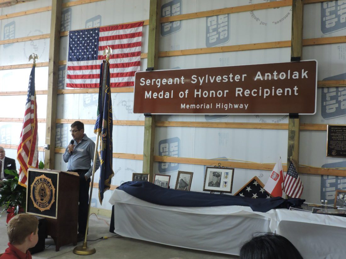 T-L Photo/ ROBERT A. DEFRANK  Sgt. Sylvester Antolak, recipient of the Medal of Honor after giving his life in World War II, is honored with the dedication of a section of Interstate 70 near St. Clairsville named in his honor. Paul Antolak, his nephew, speaks at the event.