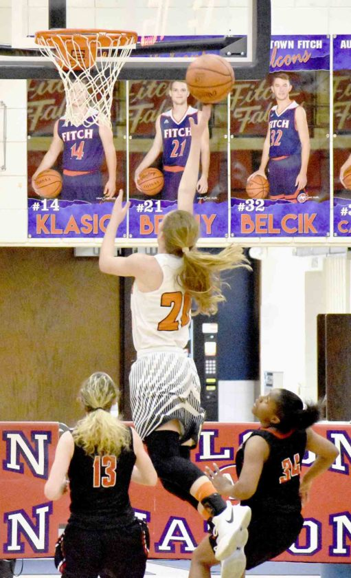 Tribune Chronicle / Marc Weems Howland's Alex Ochman, middle, makes a shot as Struthers' Alexis Bury (13) and Keasia Chism (34) look on.
