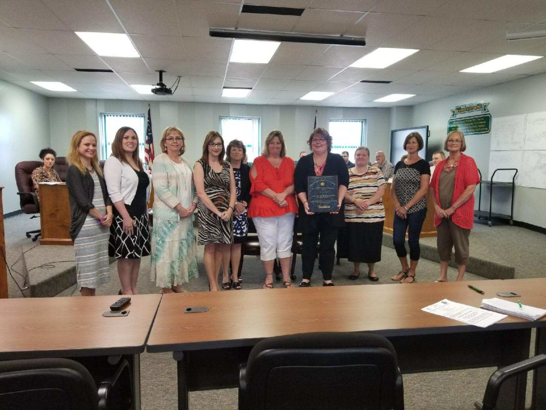 The Brooke County Board of Education on Monday recognized Colliers Primary School for being named a West Virginia School of Excellence. The school's staff includes, from left, Kristen Malinowski, Arah Barker, Zena Trimmer, Dana Stoll, Penny Foose, Shanah Perrone, Principal Jo-Ellen Connolly, Mamie Keenan, Vicky Kovach and Sharon Haught. — Warren Scott
