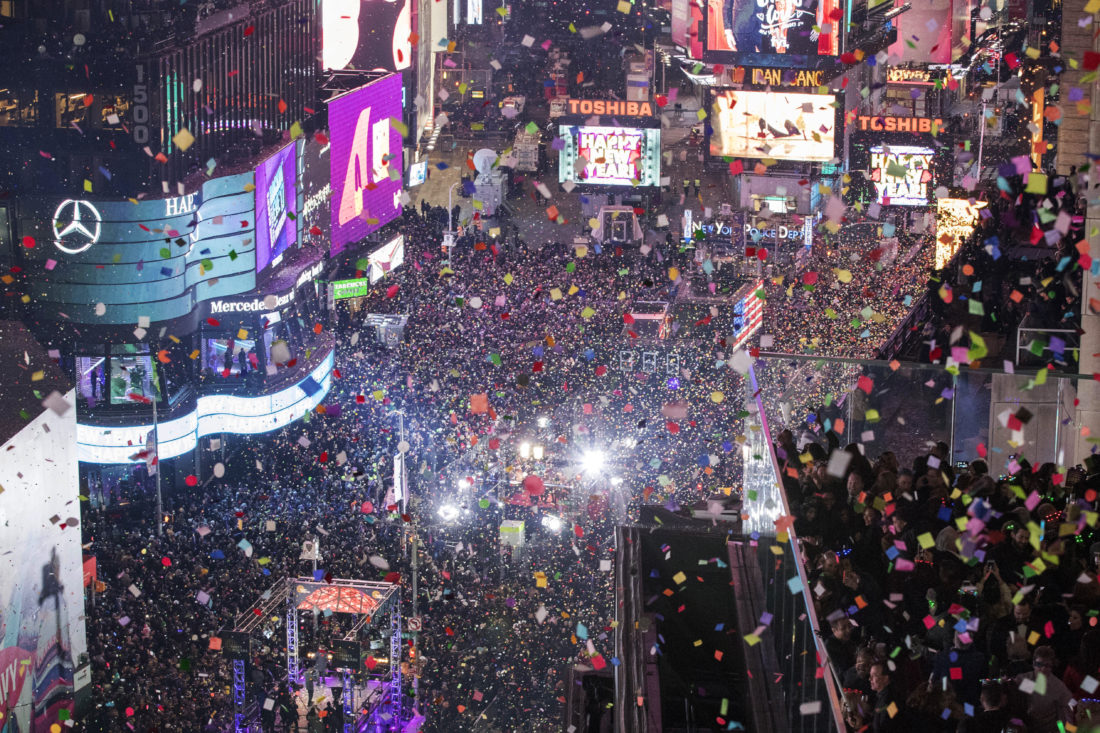 1 2017 file photo revelers celebrate the new year as confetti flies over new yorks times square year after year people watching new york citys new