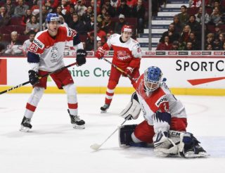 VANCOUVER, BC - DECEMBER 31: The Czech Republic's Lukas Dostal #2 makes a glove save while Daniel Bukac #23 and Denmark's Gustav Green #21 looks on during preliminary round action at the 2019 IIHF World Junior Championship at Rogers Arena on December 31, 2018 in Vancouver, BC Canada. (Photo by Matt Zambonin/HHOF-IIHF Images)