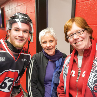 Season Ticker Holder of the Game - Linda Millins with Trent Mallette