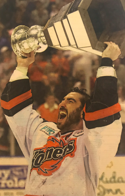 Venedam hoists the Colonial Cup with the Fort Wayne Comets of the UHL in 2003.