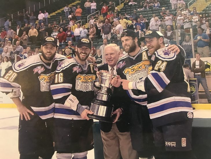 Venedam accepts the Kelly Cup as captain of the Greenville Grrrowl of the ECHL in 2002.