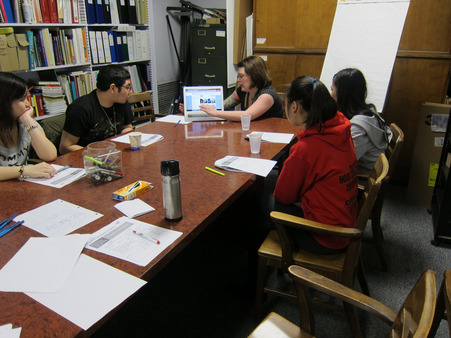 Youth participate in a research session about Free Library digital resources with a Mentor.