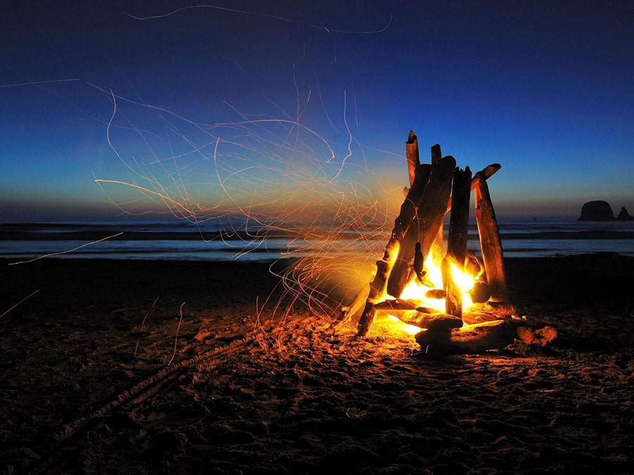 campfire on beach at night