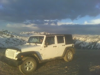jeep on snow covered mountain larry mountainborn