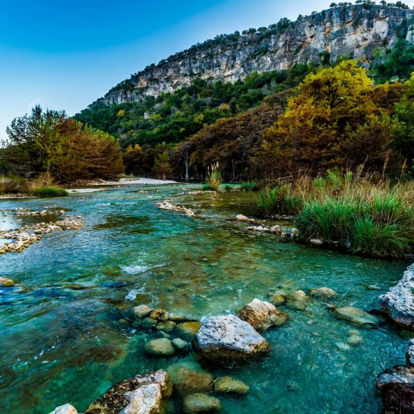 texas camping view of river running through a forested mountain range