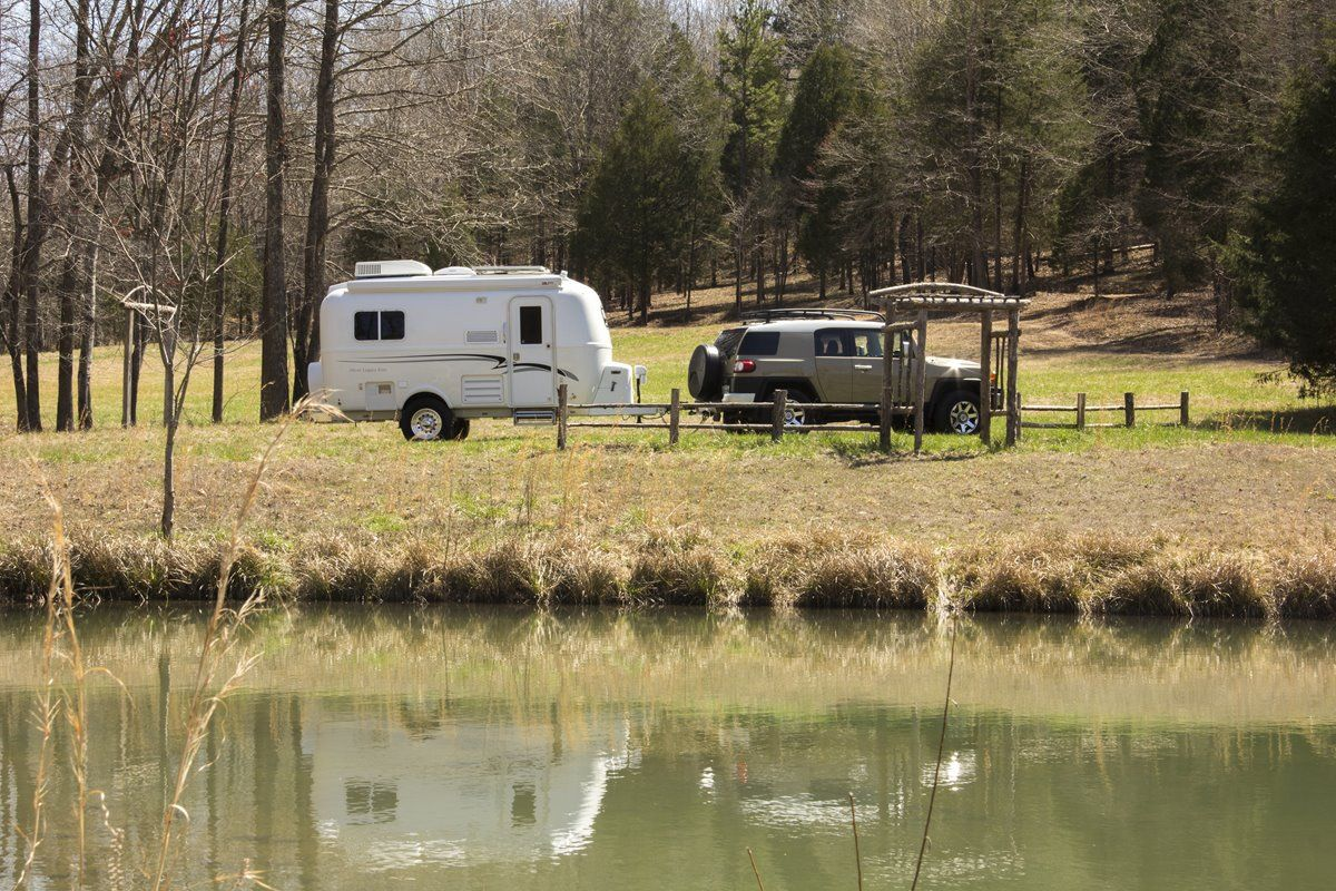 oliver travel trailers legacy elite 1 easy towing in beautiful fall with pond