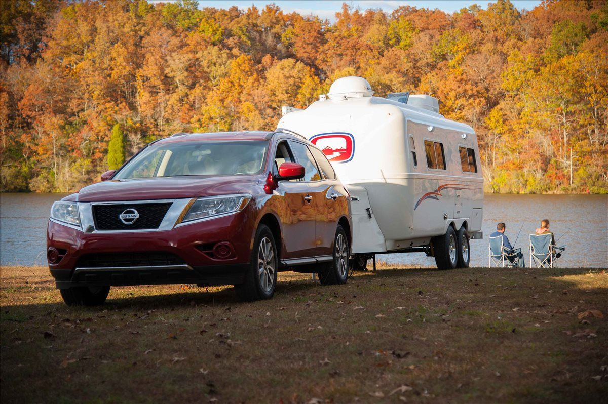 oliver travel trailers legacy elite 2 during the fall evening with a couple fishing