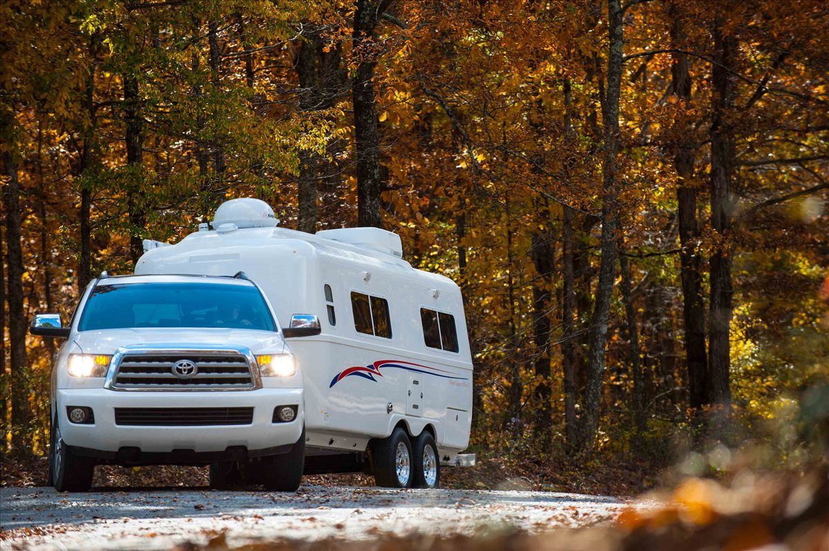 oliver travel trailers legacy elite 2 towing up the road