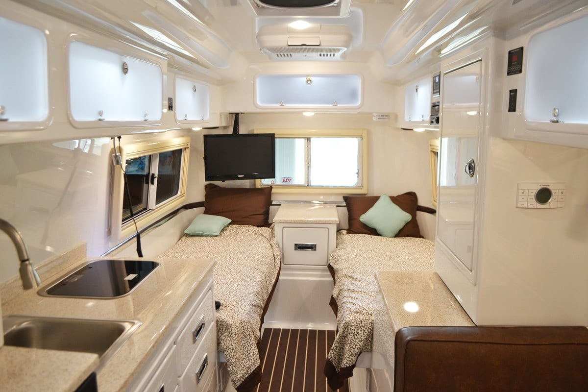 oliver travel trailers legacy elite 2 inside view fiber-granite countertops ultra leather upholstery twin bed floor plans
