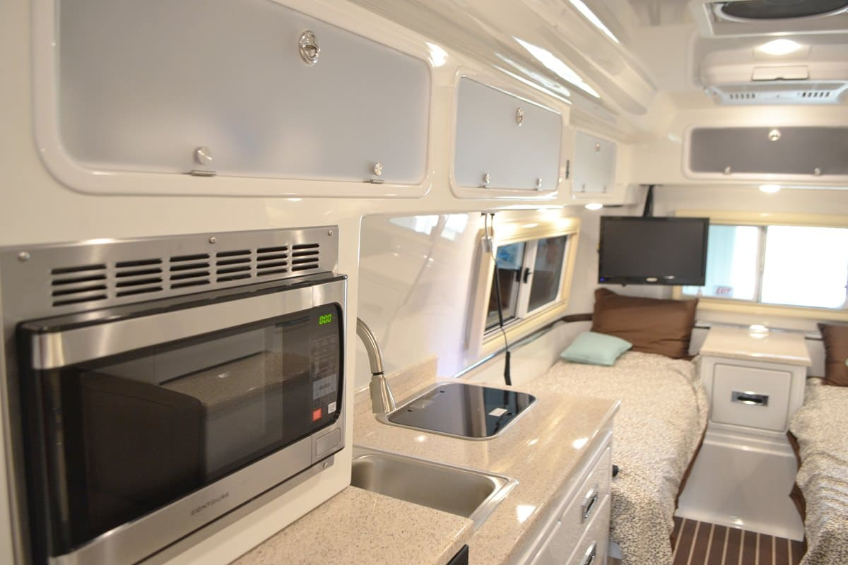 oliver travel trailers standard options frosted glass upper cabinets lights off