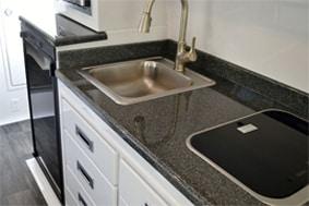 camper trailer fiber granite countertops in kitchen