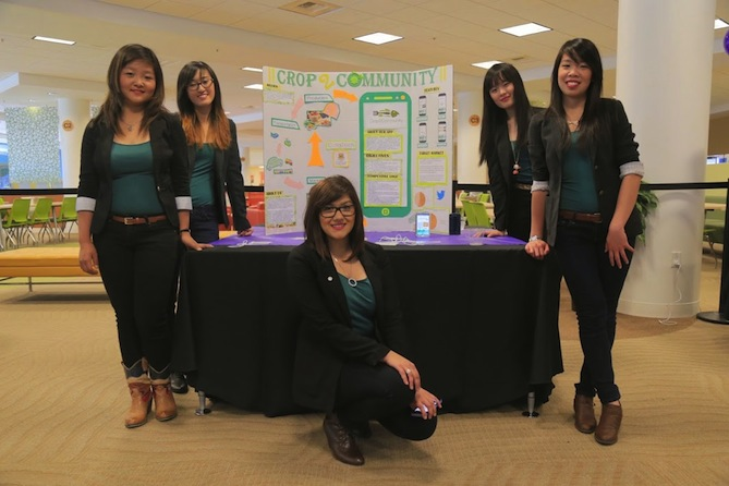 Girls from the University of Calgary display their app, Crop2Community.