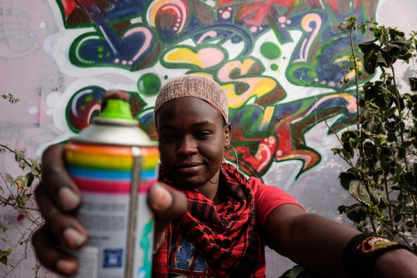 """Dakar, Senegal (April 28) - Dieynaba Sidibe, Senegal's first female graffiti artist and a slam poet, poses next to a wall she painted with the ONE slogan, """"Poverty is Sexist"""" at the Africulturban Centre in Pikine, a suburb of the capital Dakar where hip hop artists gather. Dieynaba, whose artist name is Zeinixx, often uses her graffiti to call attention to social issues in Senegal, such as womens' rights, which she says have progressed yet work remains to be done: """"One thing that should be spoken about is inquality in salaries that exist in offices - when a man and woman have the same educaiton, the same capacity for work and thought, and they don't have the same salary at the end of the month,"""" she says."""