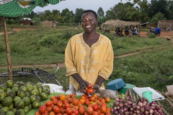 Women from the Aberu Kanyoutu group sell vegetables and fish in a local market in Pakam Kisoko, Uganda. This income generating activity was supported by DSW Uganda. (Photo credit: Jonathan Torgovnik/Reportage by Getty Images)