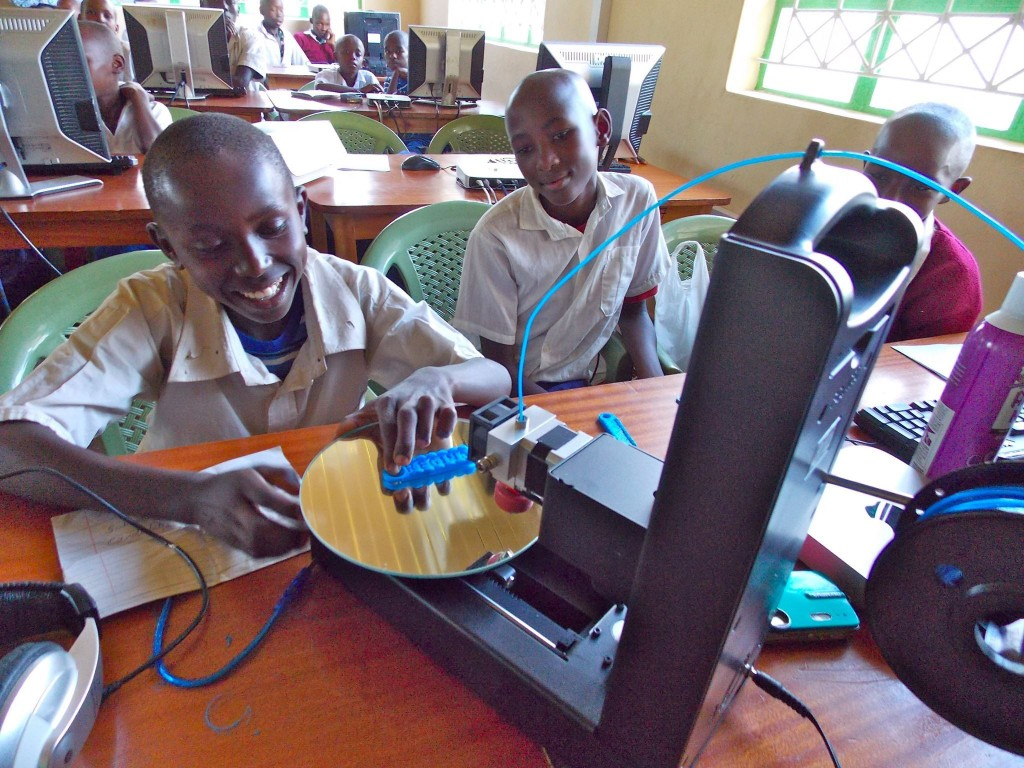 A student at Kenya Connect watches with delight as a project he designed emerges from the 3D printer. He and his classmates are participating in a global collaboration with students at New Canaan Country School through Level Up Village's Global Inventors course.